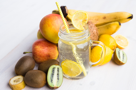 Glass of fresh lemonade in an environment of fruits Stock Photo - 98964952
