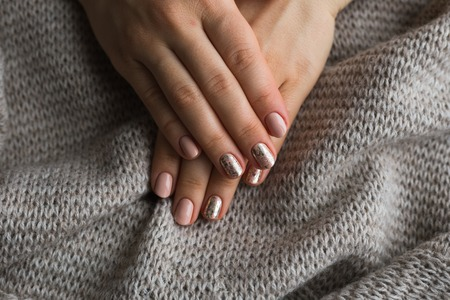 Female hands with manicure and pink polished nails