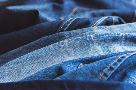 Jeans stacked on a wooden background Banque d'images - 100289445