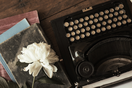 Old black typewriter with paper worth on the table Reklamní fotografie - 108732741
