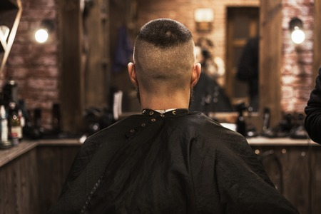 Man visiting hairstylist in barber shop