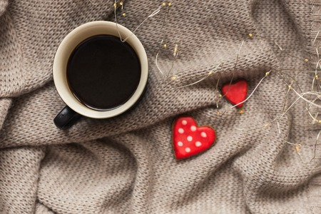 Cup of coffee and two heart shape cookies gingerbread