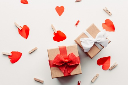 Gift with red ribbon and hearts 写真素材