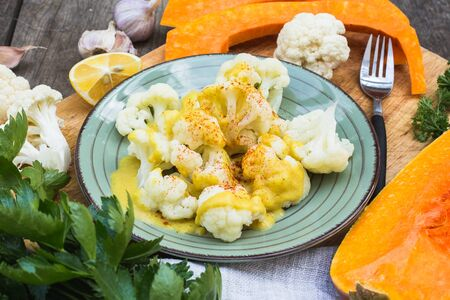 Steamed cauliflower with sauce and pumpkin