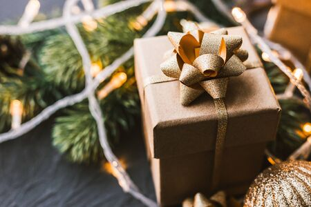 Christmas presents on a black background. Christmas background with fir tree, garlands, gifts, stars.