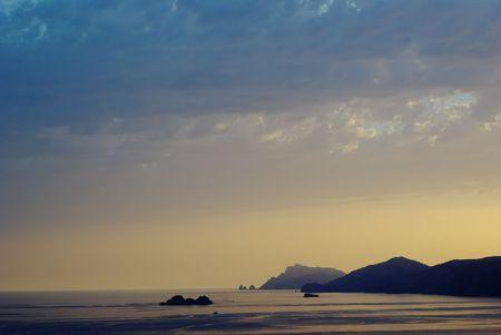 positano: Praiano sunset on the coast of Positano crag of Capri and Punta Campanella