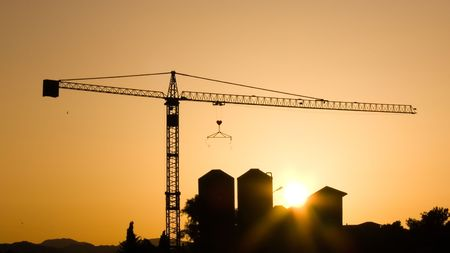 Crane for construction industry at sunset photo
