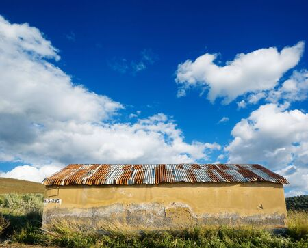 old roof of abandoned house against the cloudy sky photo