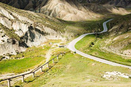twist road between green hills Stock Photo - 3368478