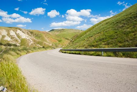 hill road with white cloud Stock Photo - 3368469