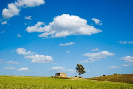 landscape for a field with a farm photo