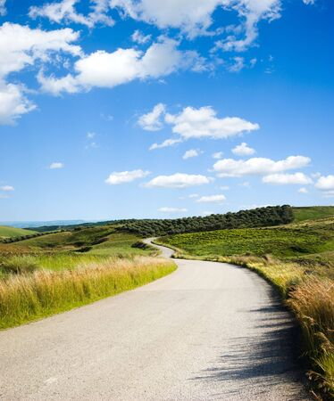 hill road with white cloud Stock Photo