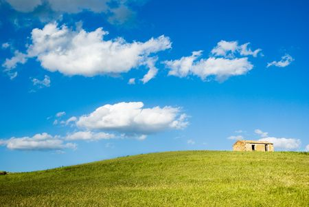 the house with green grass on the hill Stock Photo - 3368417