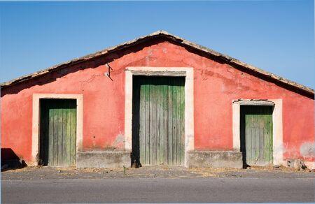 three doors on facade of a old farm  photo