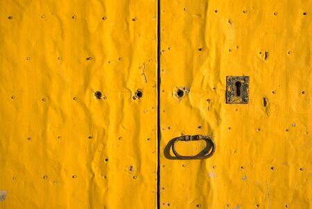 close up vintage yellow door  photo
