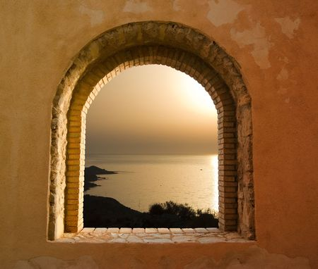 arched: sunset on the sea through the windows