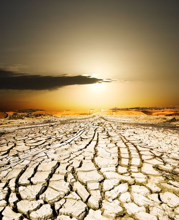 sunset on the ground dried by dryness Stock Photo - 3579220