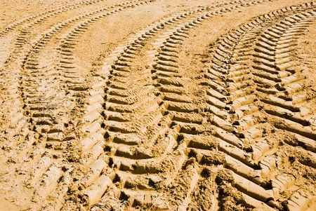 abstract composition for tracks on sand from tire photo
