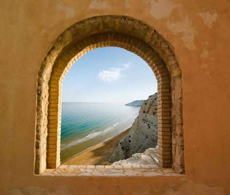 arched: arched window on the coastal landscape of a bay