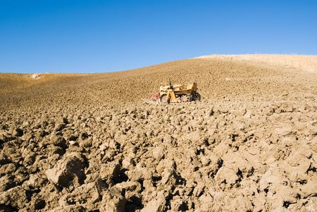 agrarian: agrarian machine in ploughed field  Stock Photo