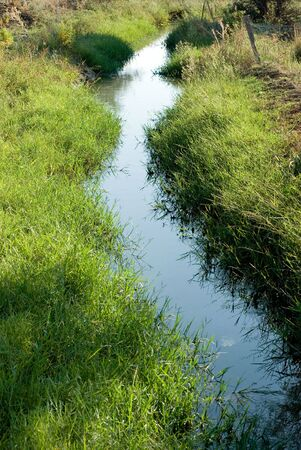 artificially: artificially flow of water for irrigation