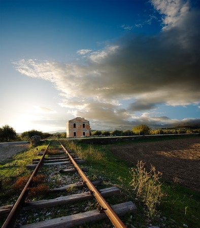 railtrack: old railway and station abandoned to sunset