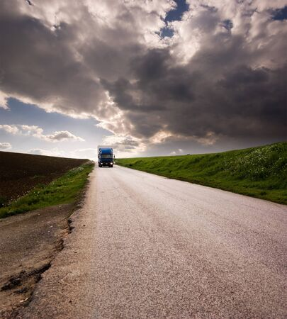 landscape for truck on road and stormy sky photo