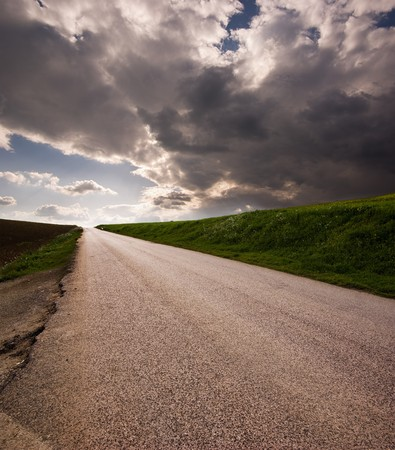 Rural road on horizon stormy clouds Stock Photo - 4571259