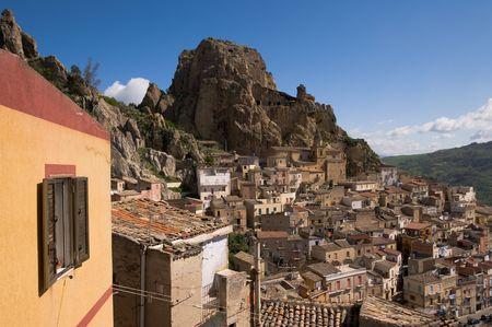 View of houses and rocky castle of village  Gagliano Castelferrato in Sicily photo