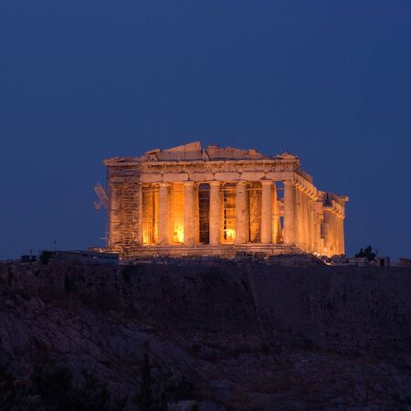 view from Filopappos-Philopappos hill of Parthenon by night in the city of Athens photo