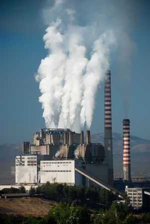 smoke stack: Steaming smoke stack and cooling tower with pollution in Megalopolis, Greece