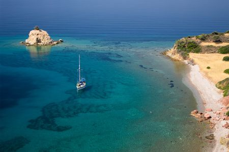 Aerial view of a sailing boat in a bay with a small island solitary Stock Photo - 5433597
