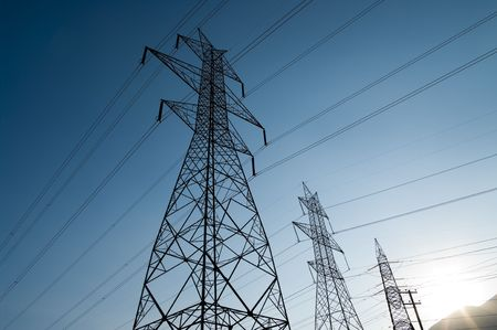 High voltage power lines at dusk. Stock Photo