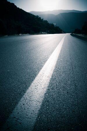 backlit for road and line roadside photo