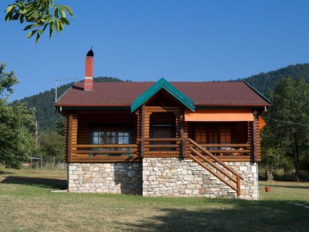 karpenisi: front view of log cabin in land considered the Swiss Alps of Greece
