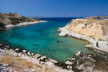bathers: bathers swim inside water like crystal of Glyfada, Athens Stock Photo