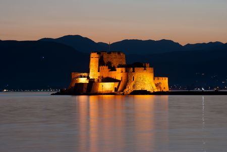 bourtzi: view by night of castle of Bourtzi on the island in the bay of Nauplia at twilight
