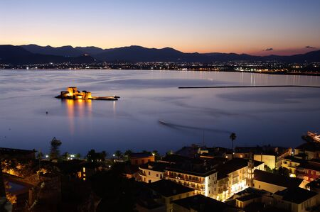 bourtzi: aerial view by night of bay Nauplia at twilight with the castle of Bourtzi on the small island