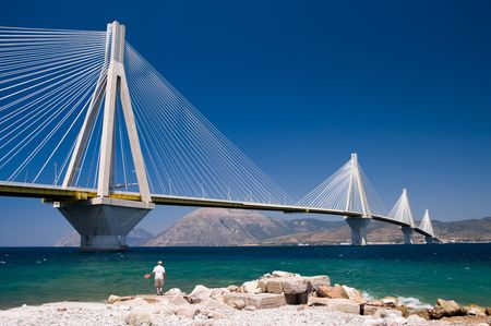 suspension bridge crossing Corinth Gulf strait, Greece.  Its official name is the Charilaos Trikoupis Bridge. The lead architect was Berdj Mikaelian. Is the worlds second longest cable-stayed deck; However, as the latter is also supported by bearings at