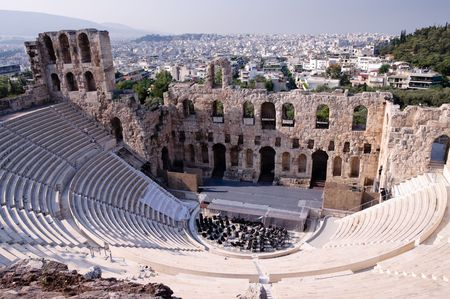 home theater: Ancient theatre of Herodes Atticus  is a small building of ancient Greece used for public performances of music and poetry, below on the Acropolis and in background dwelling of metropolis Athens Stock Photo