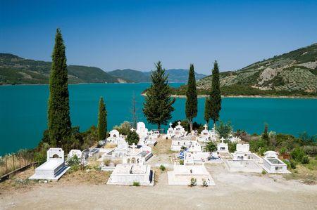 karpenisi: white cemetery on the shores of Lake Kremaston, Greece Stock Photo