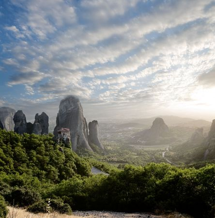 gloaming: misty at sunset of hot day on Moni Agias Varvaras Roussanou on top of rock Meteora, Greece