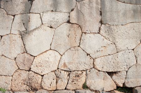 characterized:  Cyclopean wall of oracle Delphi - Greece - characterized by the use of massive stones of irregular shape and size of passage