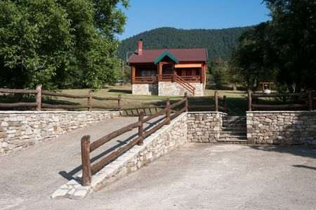 front view of log cabin in land considered the Swiss Alps of Greece Stock Photo - 5993485