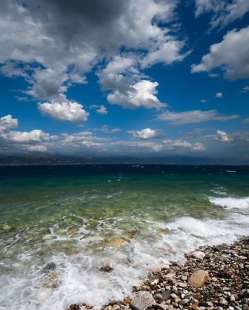 dramatic cloudscape on shore of the greek sea of Corintho strait Stock Photo - 6070672