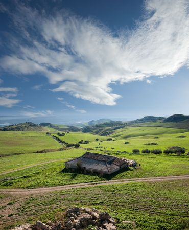 high view of farmhouse and green valley Stock Photo - 6139140