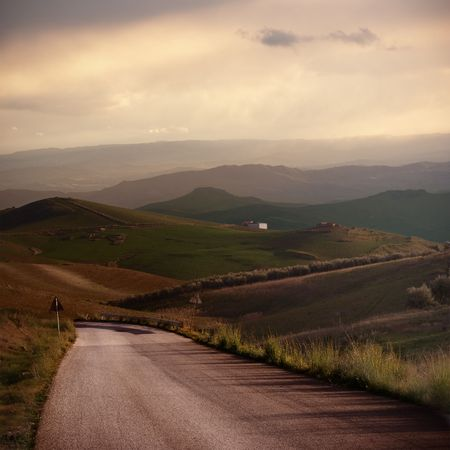 abandoned road crosses of a rural and hilly area at evening Stock Photo - 6322947