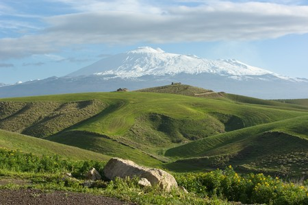 sicilian: the majestic Etna dominates the rolling hills of the hinterland of Sicily