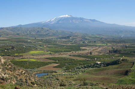 cultivated: cultivated land in a beautiful valley of the sicilian interland under the majestic volcano Etna