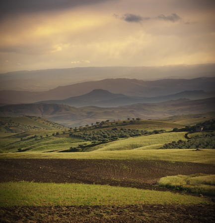 sicilian: a rural and hilly area in sicilian outback at evening